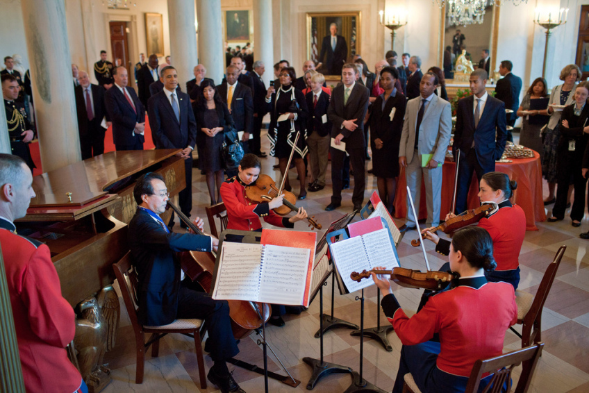 President Barack Obama and guests listens as Yo-Yo Ma plays with the Marine Band String Quartet in the Grand Foyer of the White House following the 2010 Presidential Medal of Freedom award ceremony, Feb. 15, 2011. Ma, who received a Medal of Freedom, performed an impromptu song with the group. (Official White House Photo by Pete Souza) This official White House photograph is being made available only for publication by news organizations and/or for personal use printing by the subject(s) of the photograph. The photograph may not be manipulated in any way and may not be used in commercial or political materials, advertisements, emails, products, promotions that in any way suggests approval or endorsement of the President, the First Family, or the White House.
