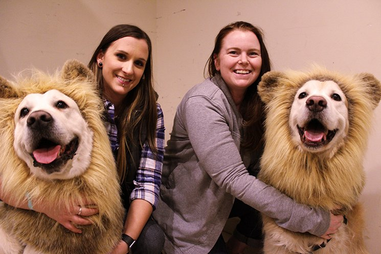 Kelsey Lamm and Morgan (left) and Cassandra Dixon and Louie (right) relax in a backstage dressing room just after the canine stars have gotten into costume