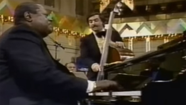 This Video of Pianist Oscar Peterson Tearing It Up While John Williams Conducts Will Give You Life