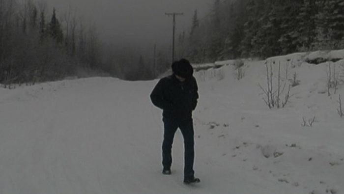 John Luther Adams trudges through the mountain snow