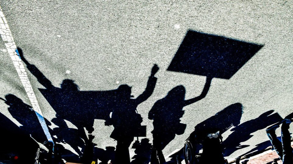 Protesters' shadows on the street as they march for their beliefs