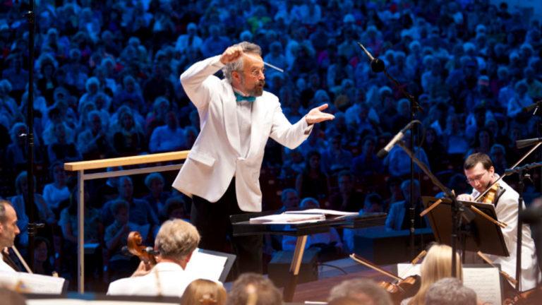 Conductor Carlos Kalmar leads the Grant Park Orchestra.