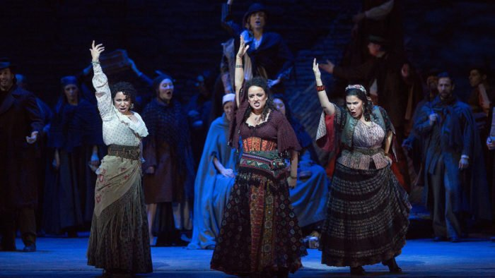 Shirin Eskandani as Mercédès, Clémentine Margaine in the title role, and Danielle Talamantes as Frasquita in Bizet's Carmen. Photo by Marty Sohl/Metropolitan Opera.