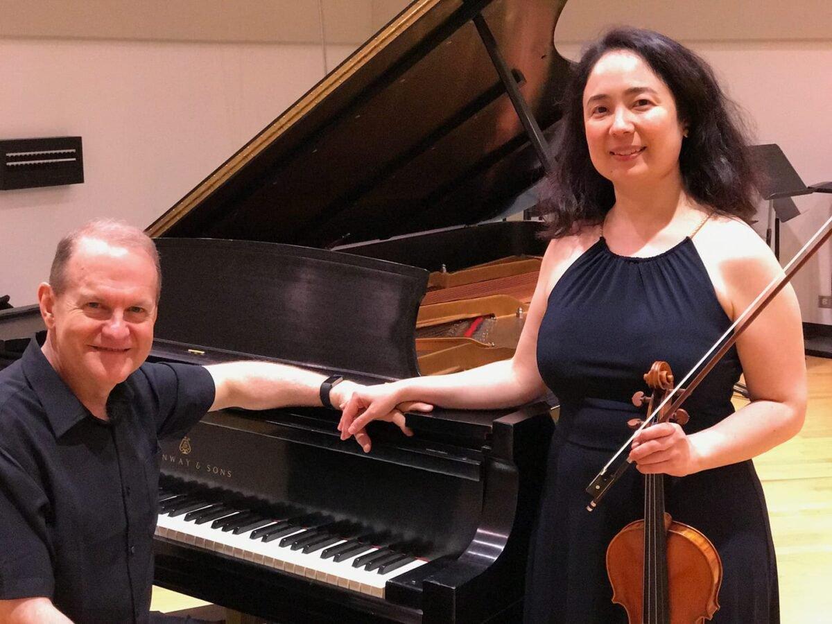 Dennis Moore at the piano with his partner Sara Su Jones in WFMT's Levin Performance Studio color photo piano violin recording studio WFMT radio