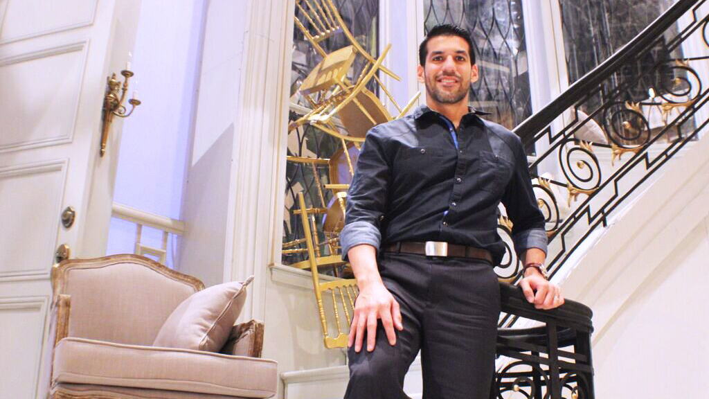 """Composer Jimmy López on the set of """"Bel Canto,"""" in its world-premiere production at Lyric Opera of Chicago, which commissioned the opera. The set is designed by David Korins."""