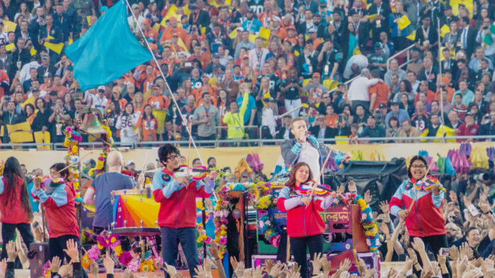 Members of Youth Orchestra of Los Angeles perform at the Halftime Show of Super Bowl 50 with Coldplay's Chris Martin (Photo: Arnie Papp)