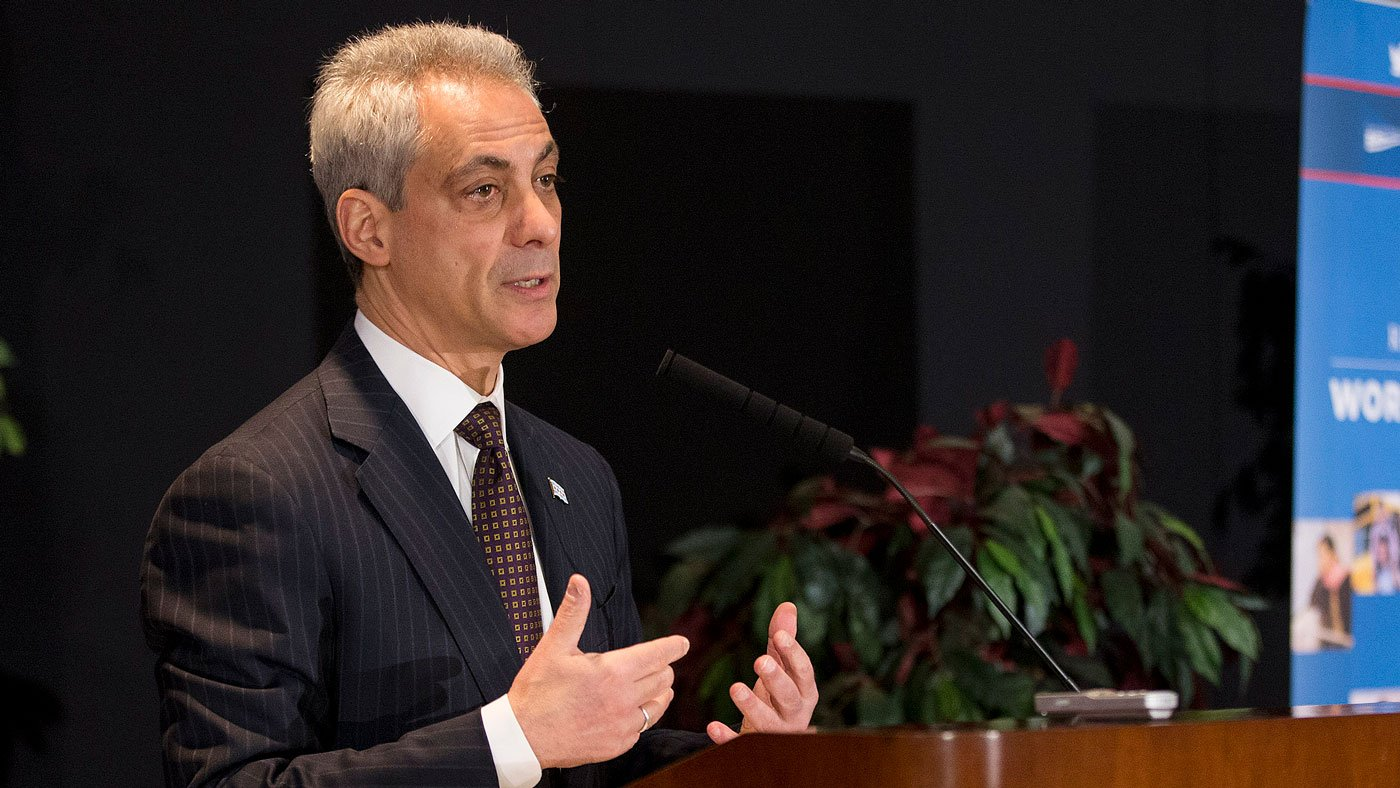 Rahm Emanuel speaking at a lectern
