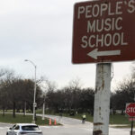 A street sign pointing towards The People's Music School