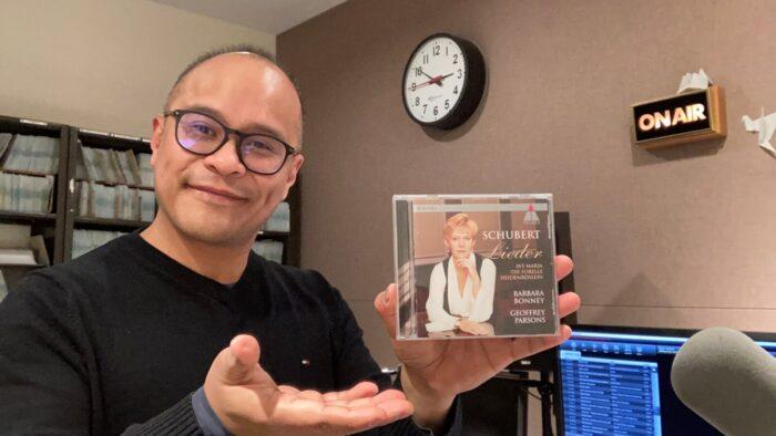 Oliver Camacho holding a CD: Schubert Lieder by Barbara Bonney and Geoffrey Parsons
