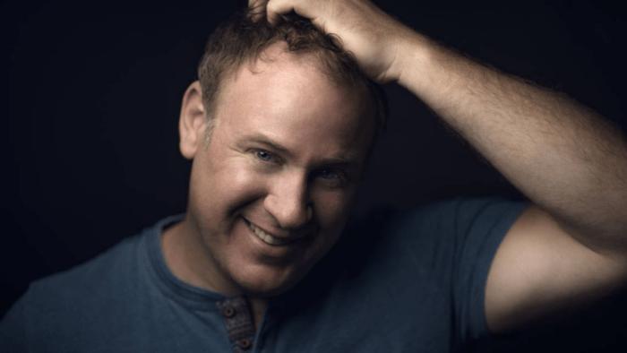 Lucas Meachem portrait, scratching head
