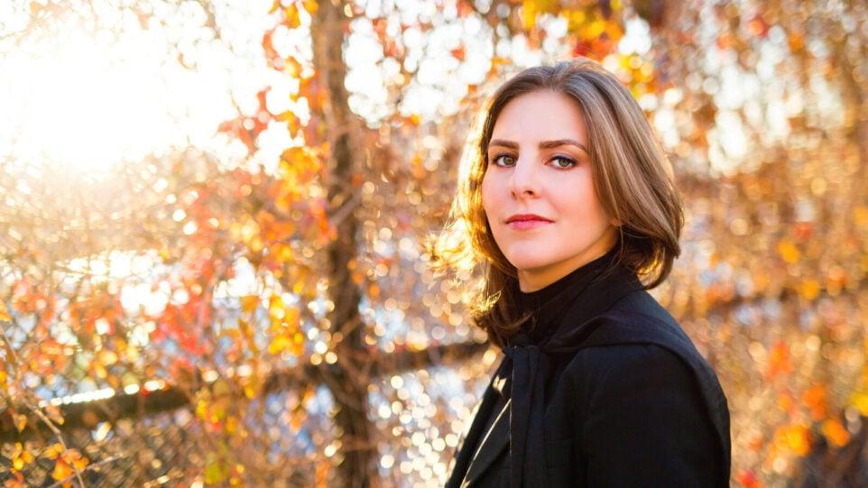 Portrait of Lidiya Yankovskaya in black suit, fall landscape background